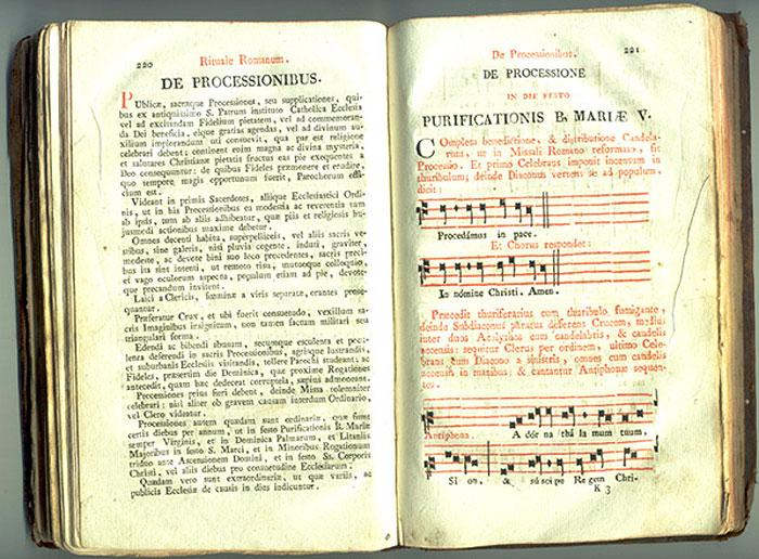 Catholic Missal - Music from a missal. The staff lines are printed using type while the notes are written by hand.
