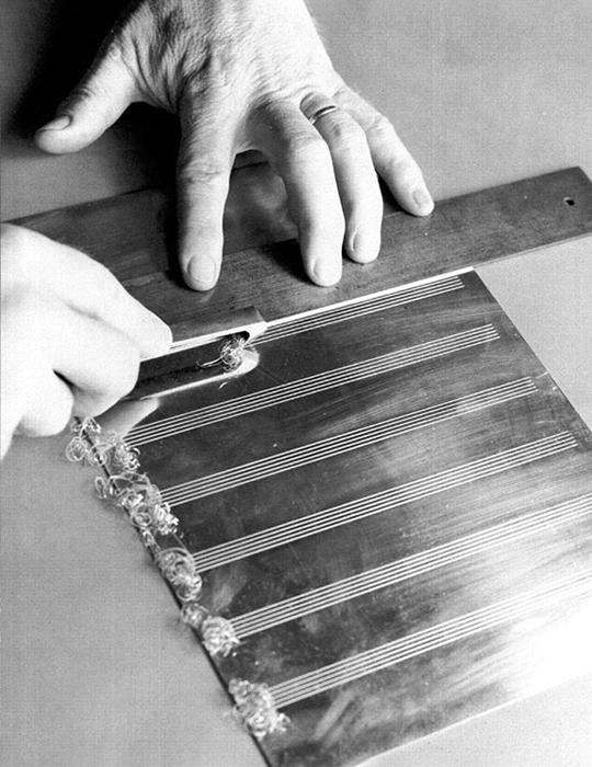 Engraving staff lines onto a metal plate with a rastral