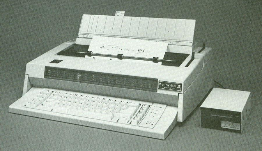 MUSICWRITER II is shown with optional plug-in disc drive using 3½ inch disc with 720,000 memory and unlimited storage.